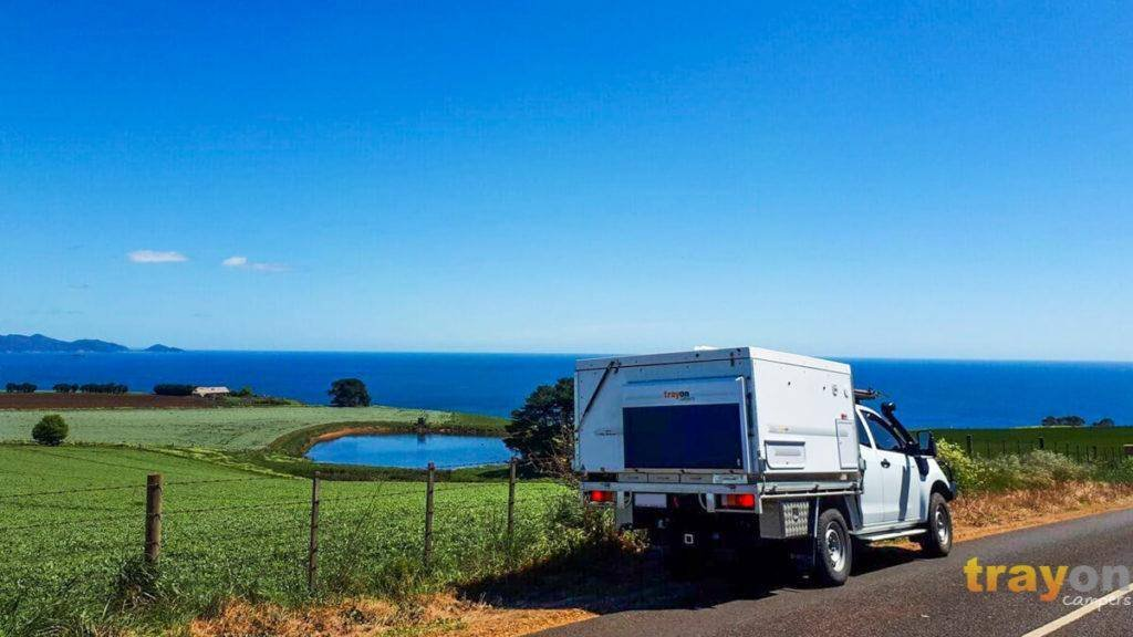 White Single Cab 2018 Isuzu Dmax 4x4 ute with Trayon Slide on Camper side of the road, solar panel